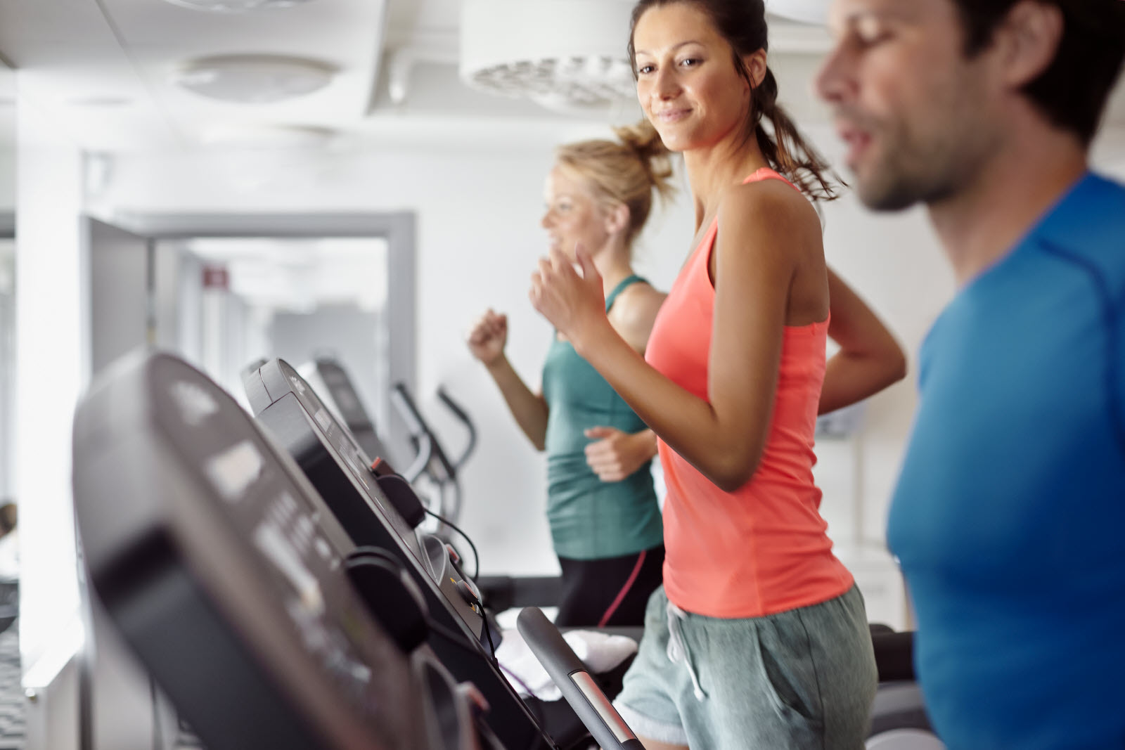 Three persons running on the treadmill in our gym