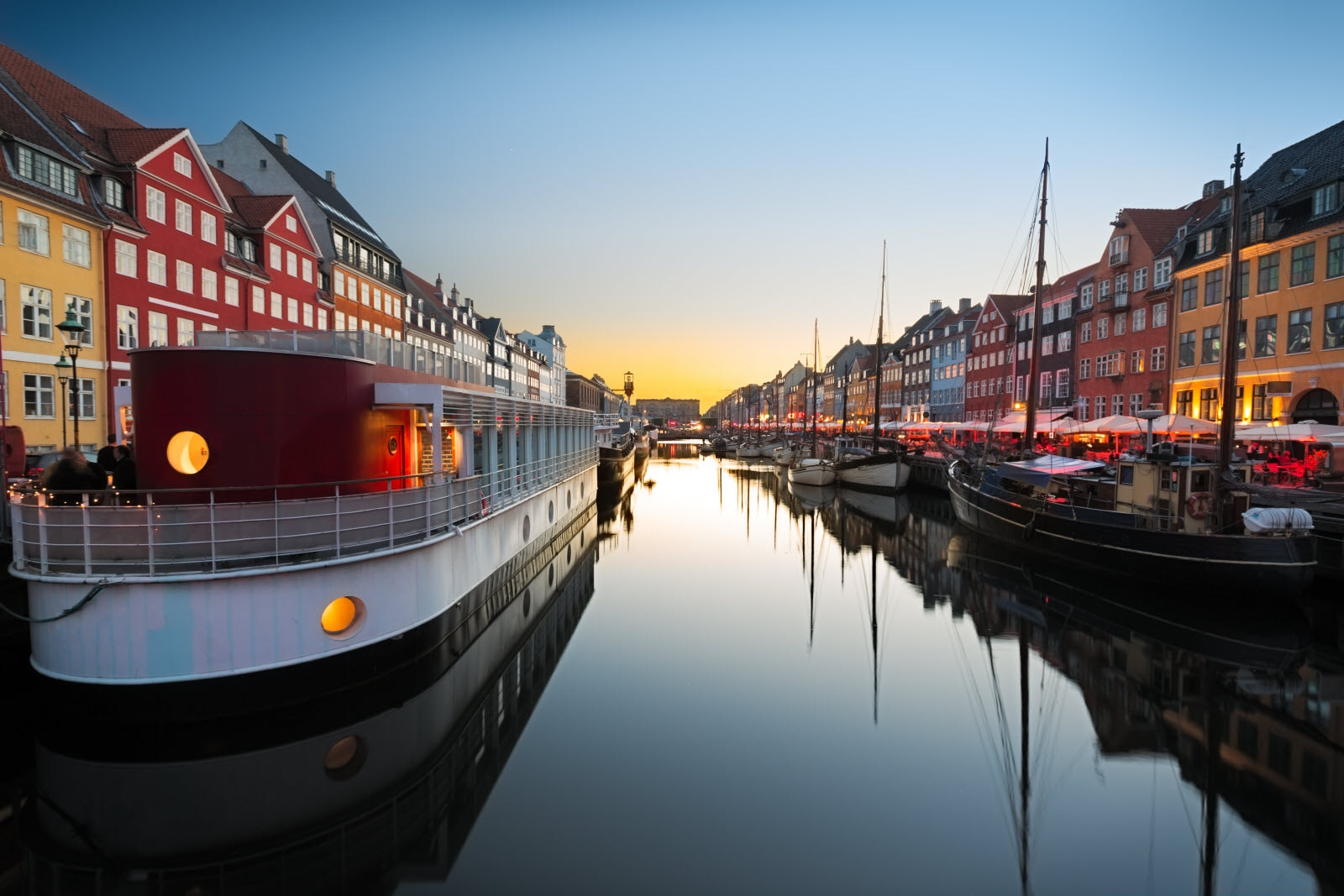 Ships in Nyhavn at sunset, Copenhagen, Denmark