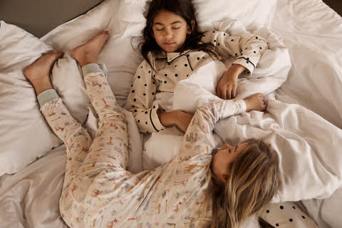 girls sleeping in bed at scandic hotels
