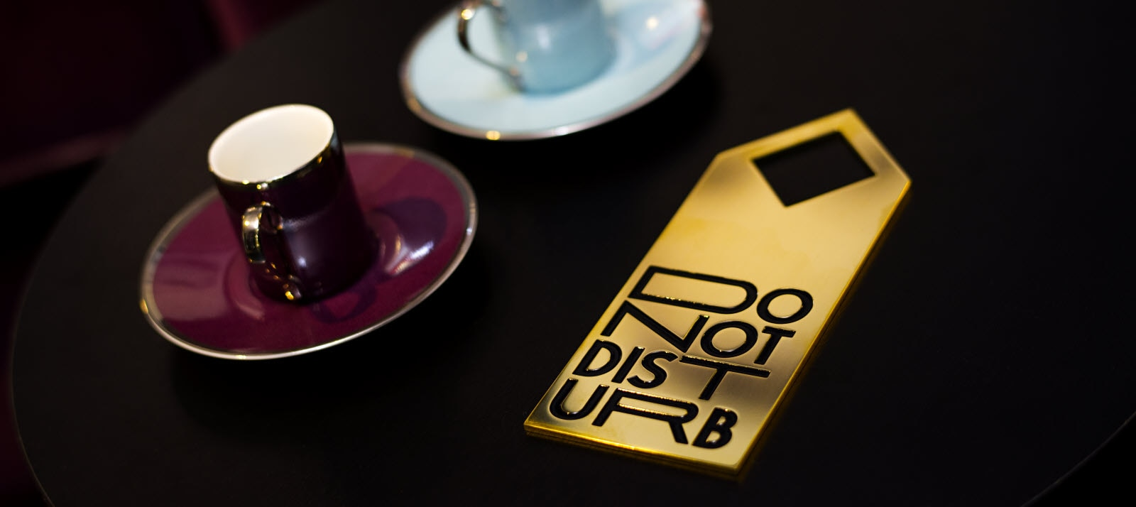 Do not disturb sign in gold and black