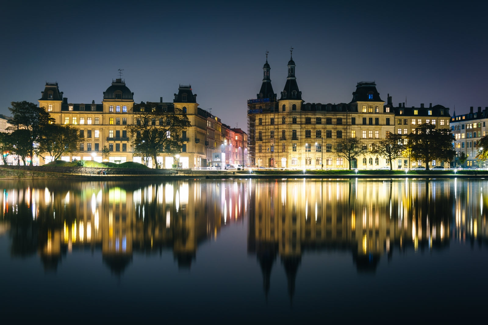 Buildings along Peblinge Sø at night, in Copenhagen.