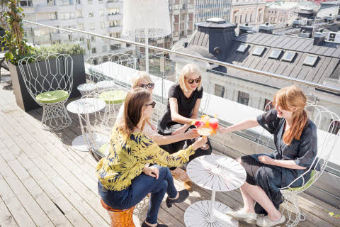 Friends having drink on Rooftop bar