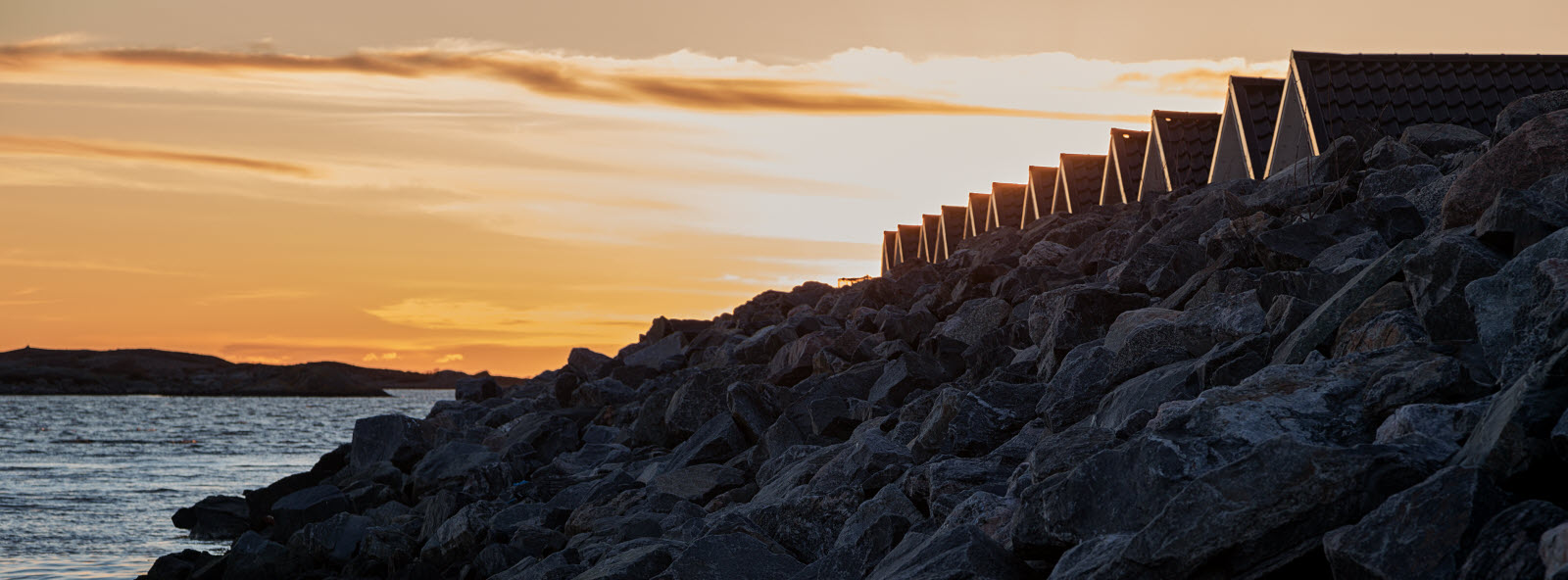 16054746-coastal-sunset-with-breakwater-made-of-ro.jpg
